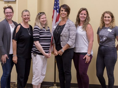 six women at a lakes area professional women's event