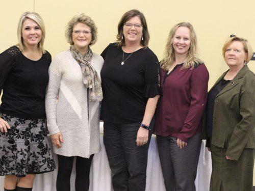 five women at a lakes area professional women's event
