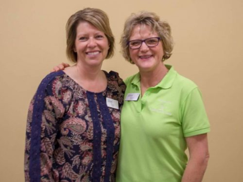 two women at a lakes area professional women's event